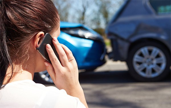 Woman on a phone after a car accident